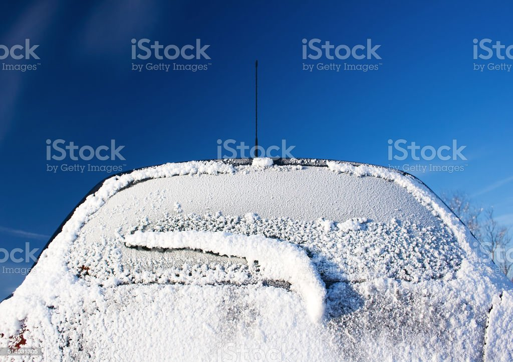Rear car window covered with ice stock photo