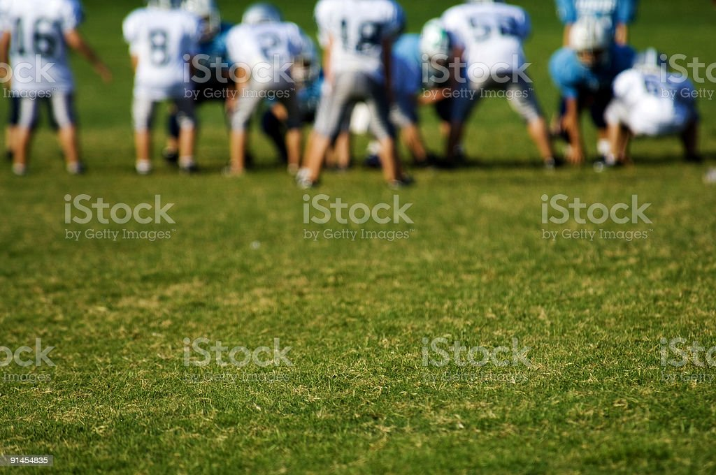 Rear distant view of American football players on the field royalty-free stock photo