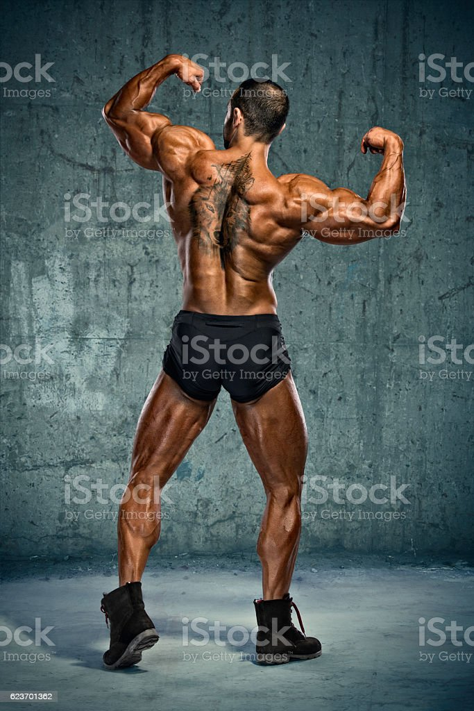 Rear Double Biceps Pose stock photo