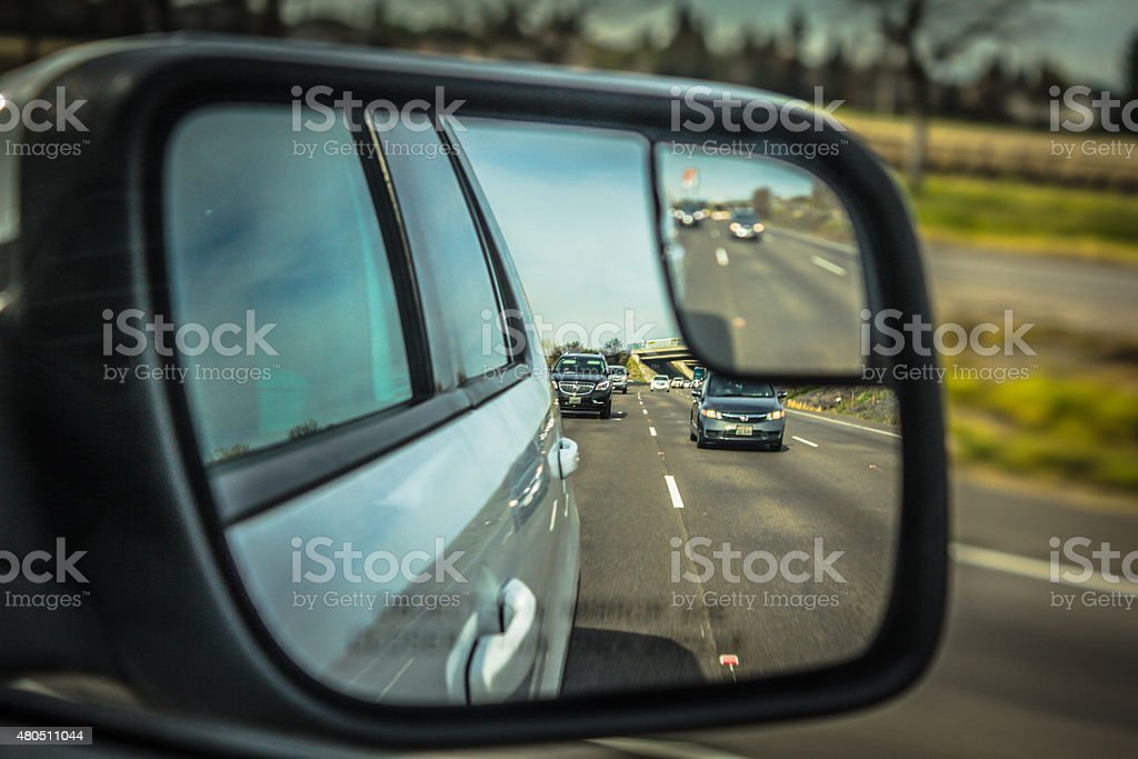 Rear mirror reflection of US interstate road, california stock photo
