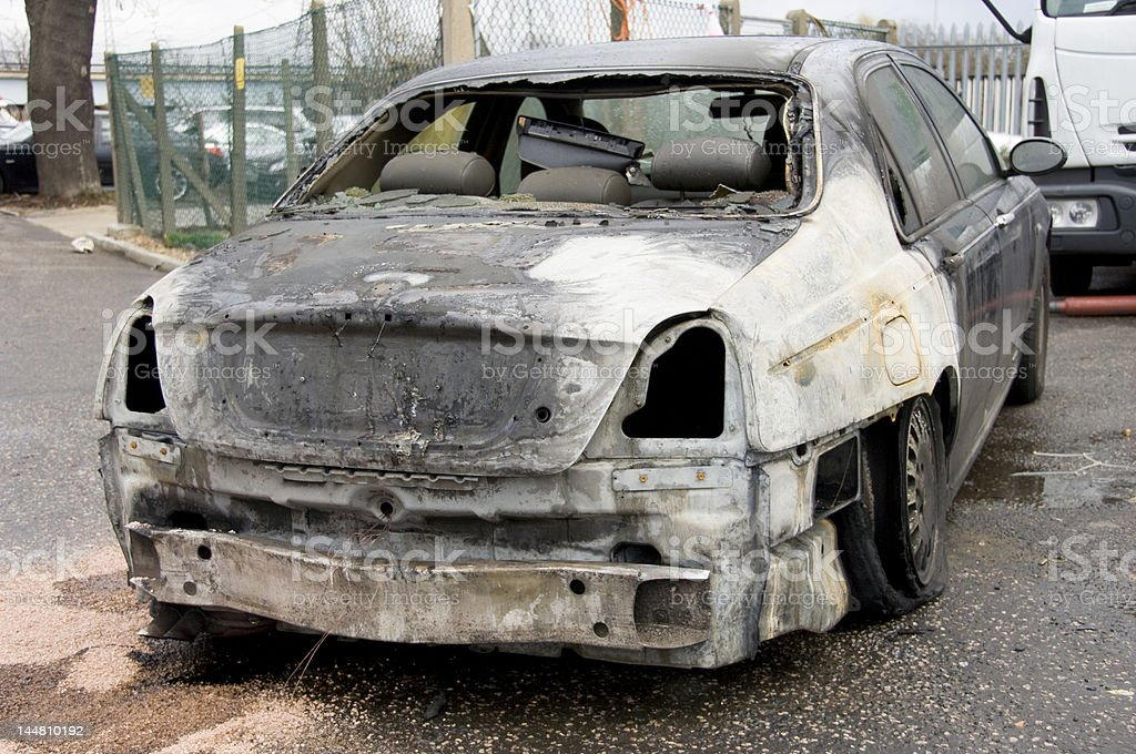 Rear of burnt out stolen saloon car stock photo