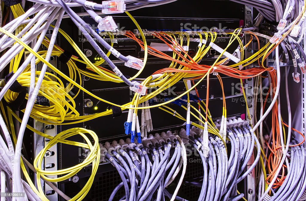 rear of device with cables and patch cords stock photo