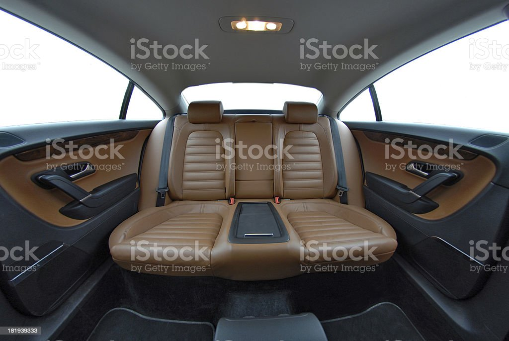 Rear of nice car with brown leather seats and center console stock photo