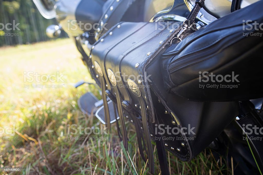Rear part of motorcycle. Black leather bag stock photo