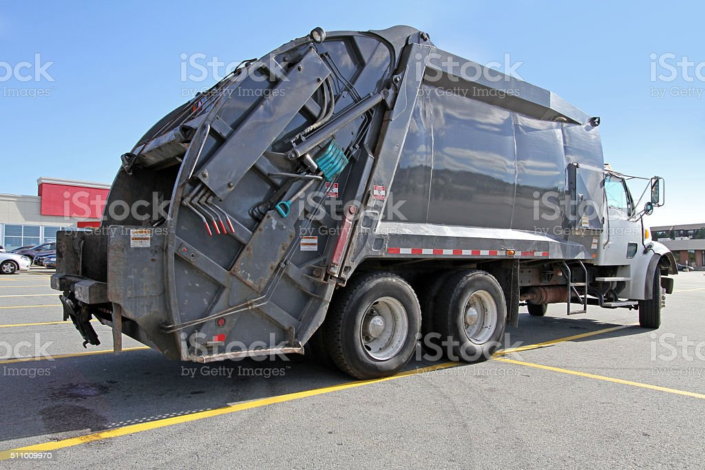 Rear Quarter View Of A Waste Management Vehicle stock photo