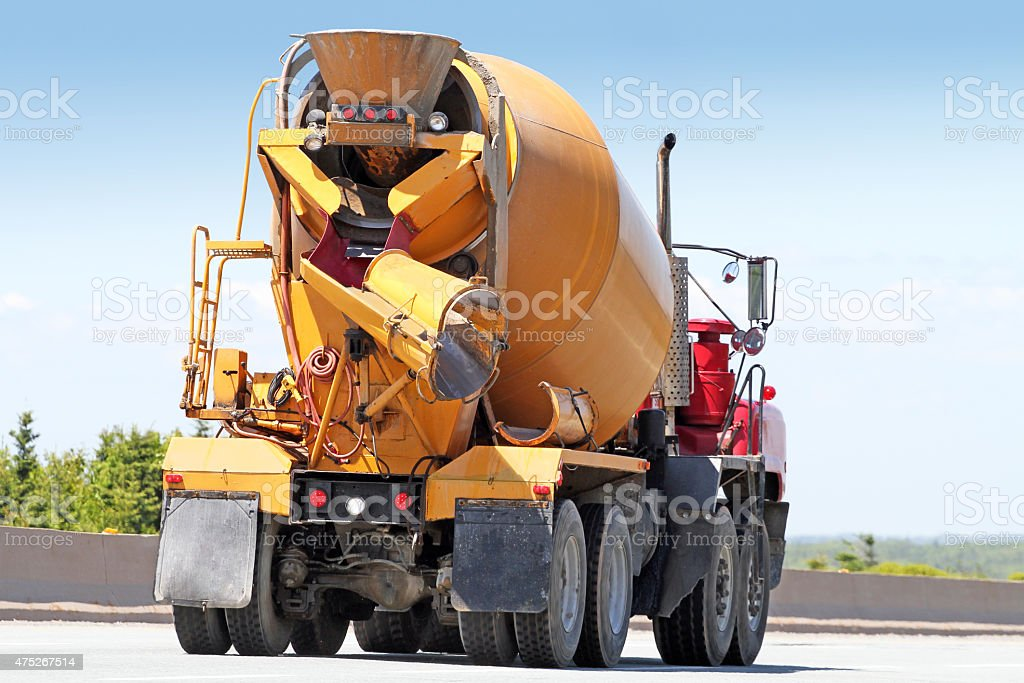 Rear Quarter View Of Cement Truck Travelling To  Construction Site stock photo
