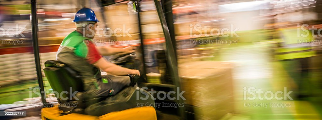 Rear Shot of a Turning Forklift in a Warehouse stock photo