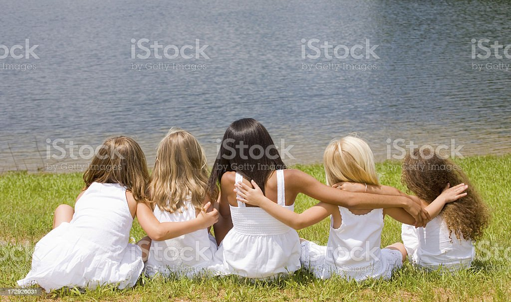 Rear shot of five young girls by a lake royalty-free stock photo
