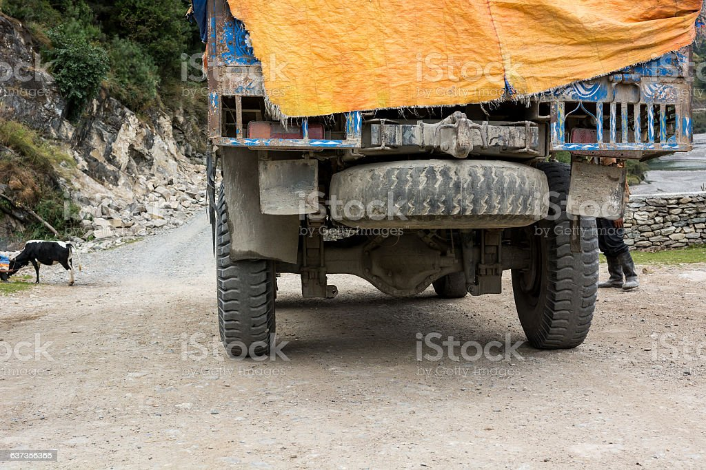 Rear side of an old truck with spare tyre. stock photo