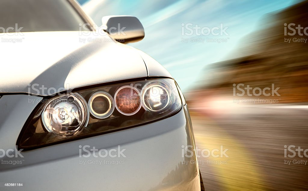 rear side view of a sport car in blurred motion stock photo