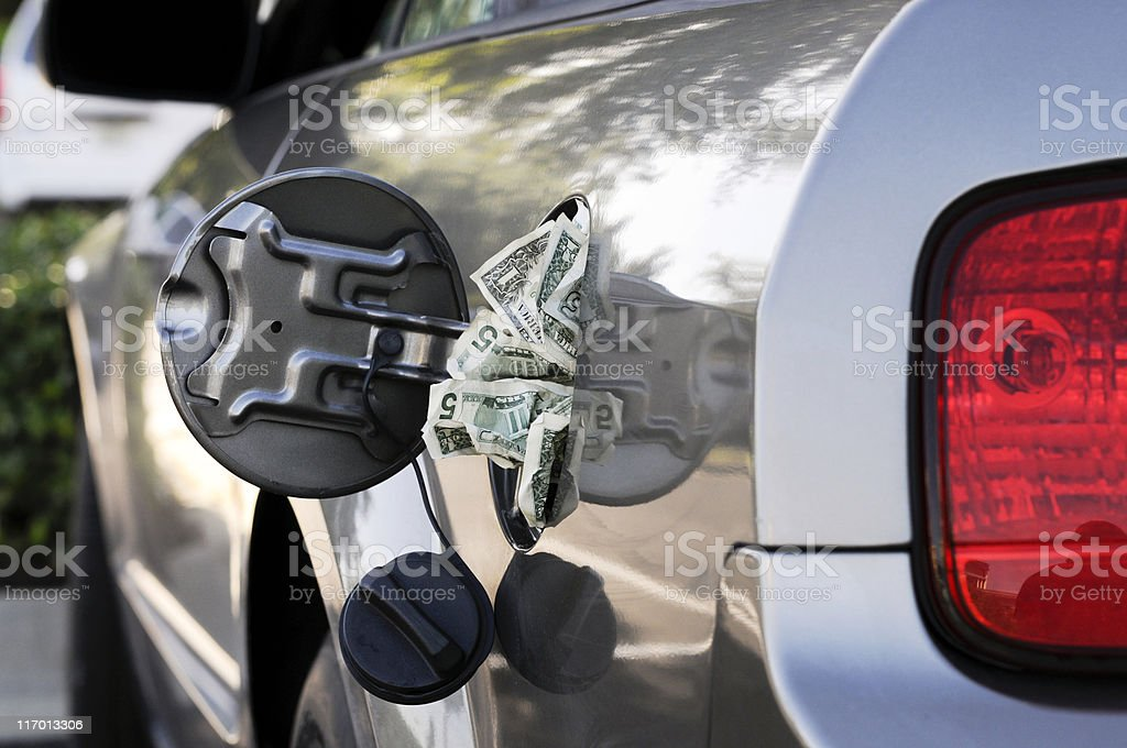 Rear Side view of Gas Tank With Money stock photo