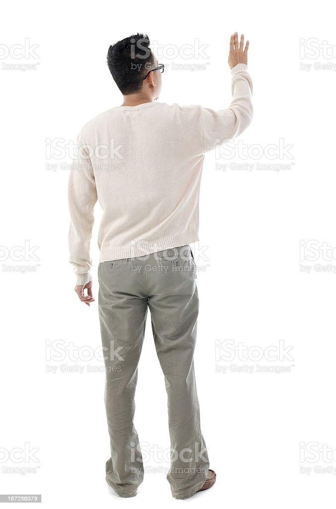 Rear view Asian man touching on transparent virtual screen stock photo