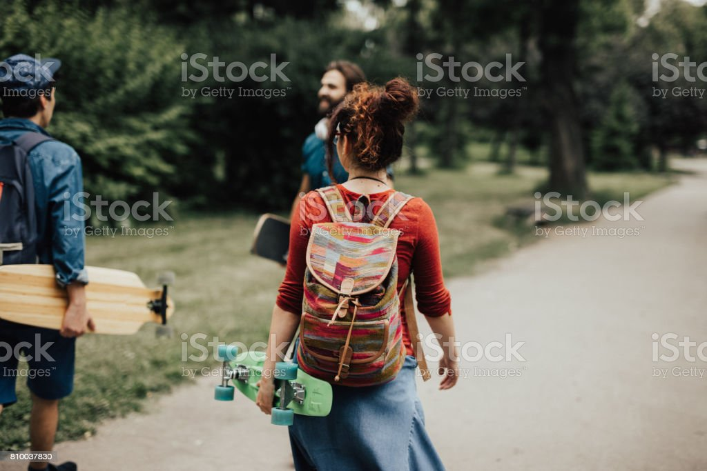 Rear view at three skaters with different skateboarders stock photo