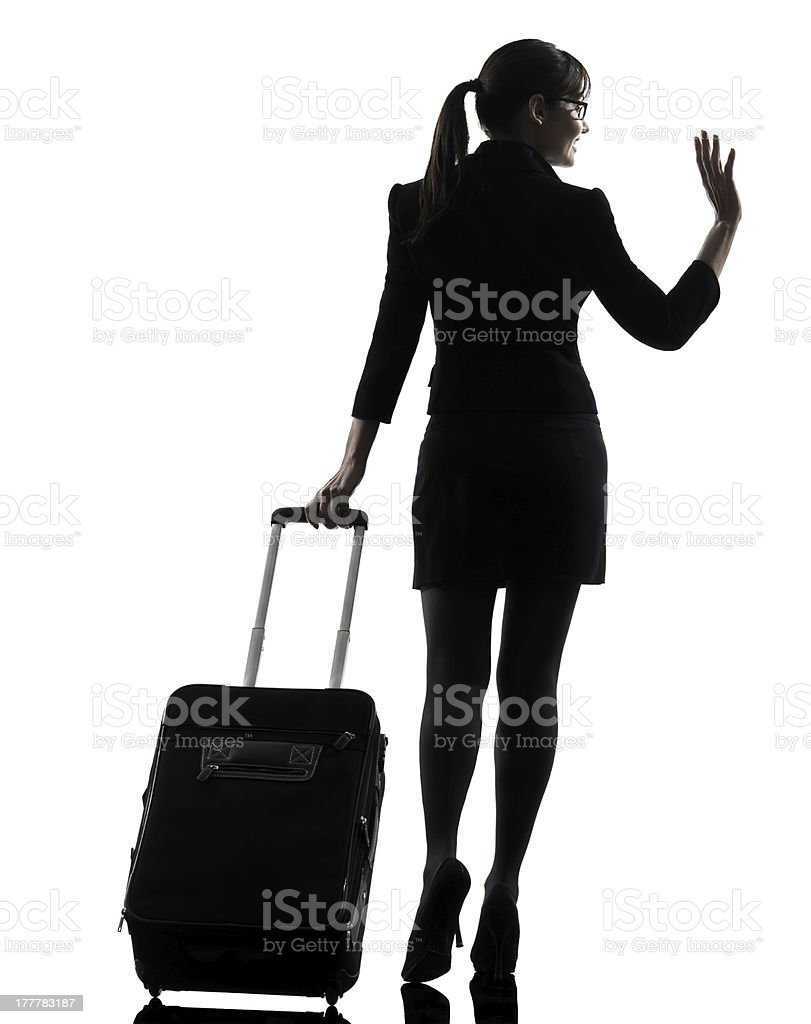 rear view business woman traveling saluting silhouette royalty-free stock photo