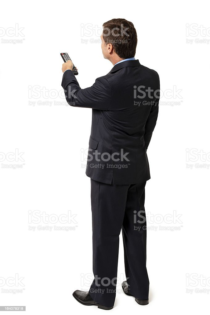 Rear View Businessman with Remote Control Isolated on White Background royalty-free stock photo