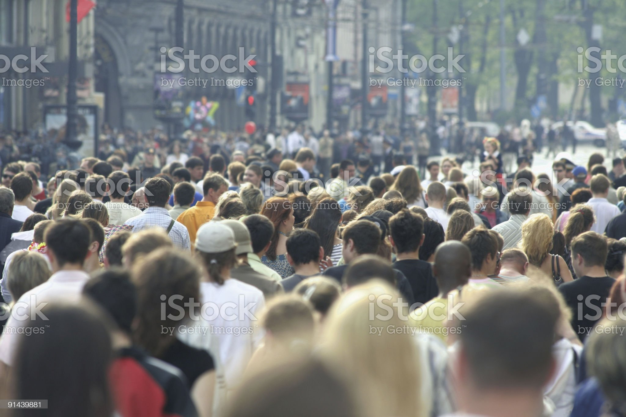 Rear view crowd in urban area during warm weather royalty-free stock photo