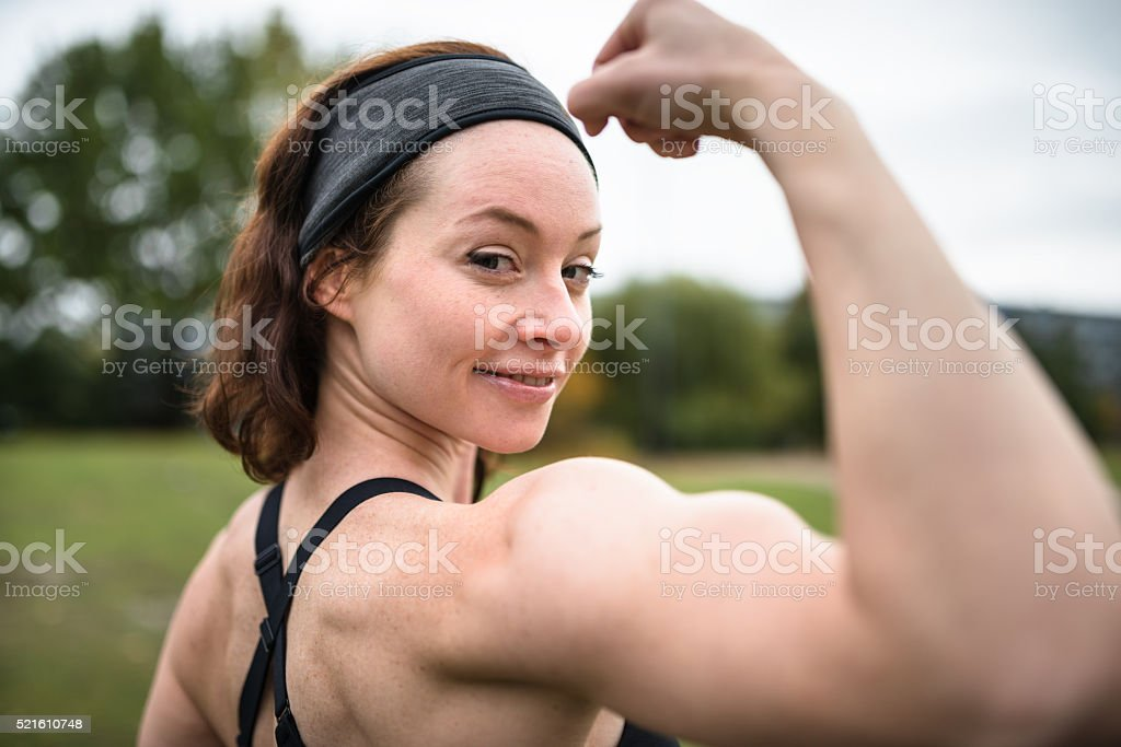 rear view Fitness woman showing the muscle stock photo