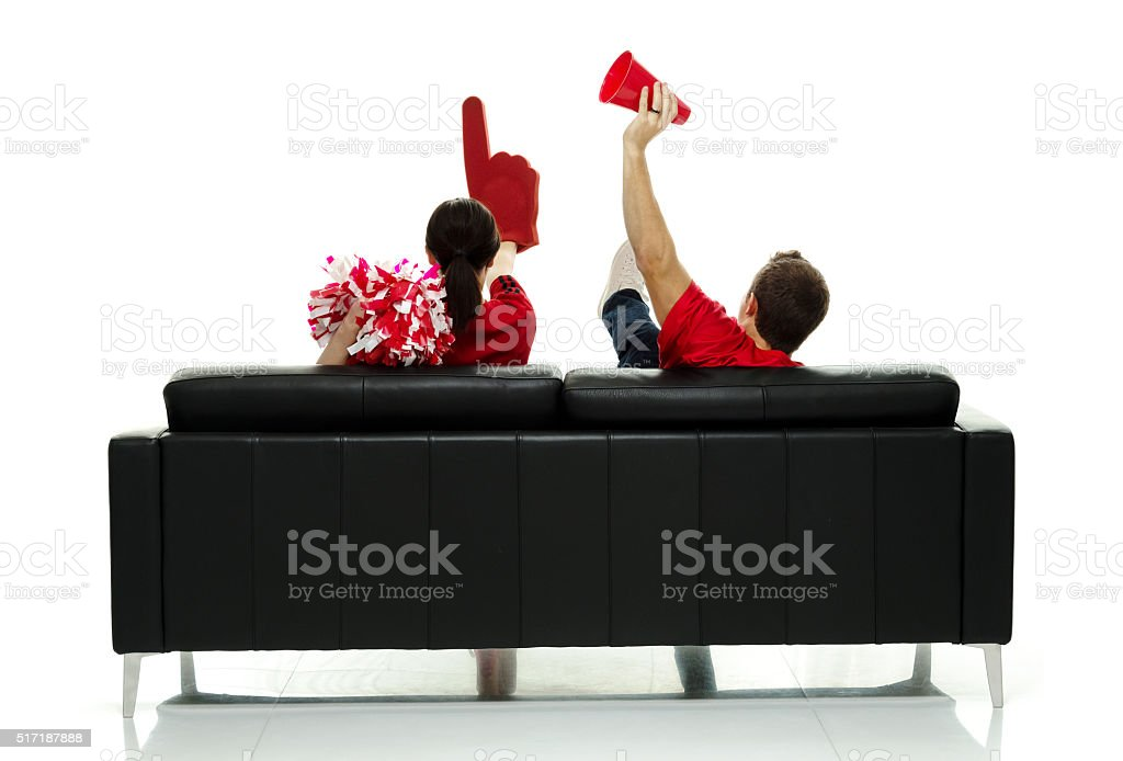 Rear view football fans cheering stock photo