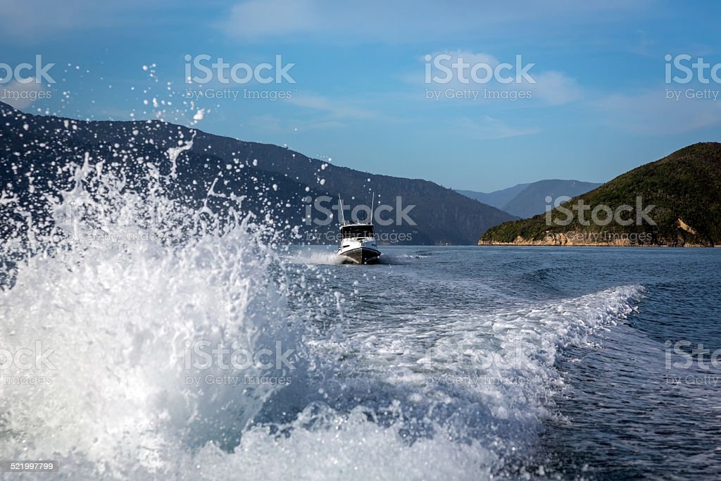 Rear View From Boat Speeding on a Lake stock photo