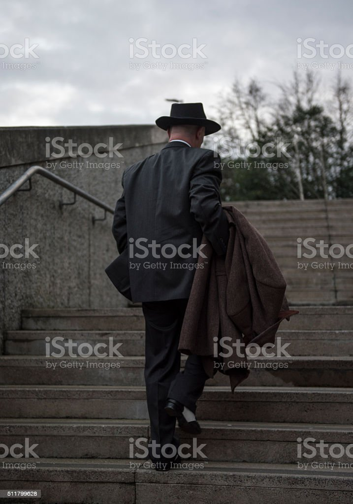 Rear view image of a mature man in a suit stock photo