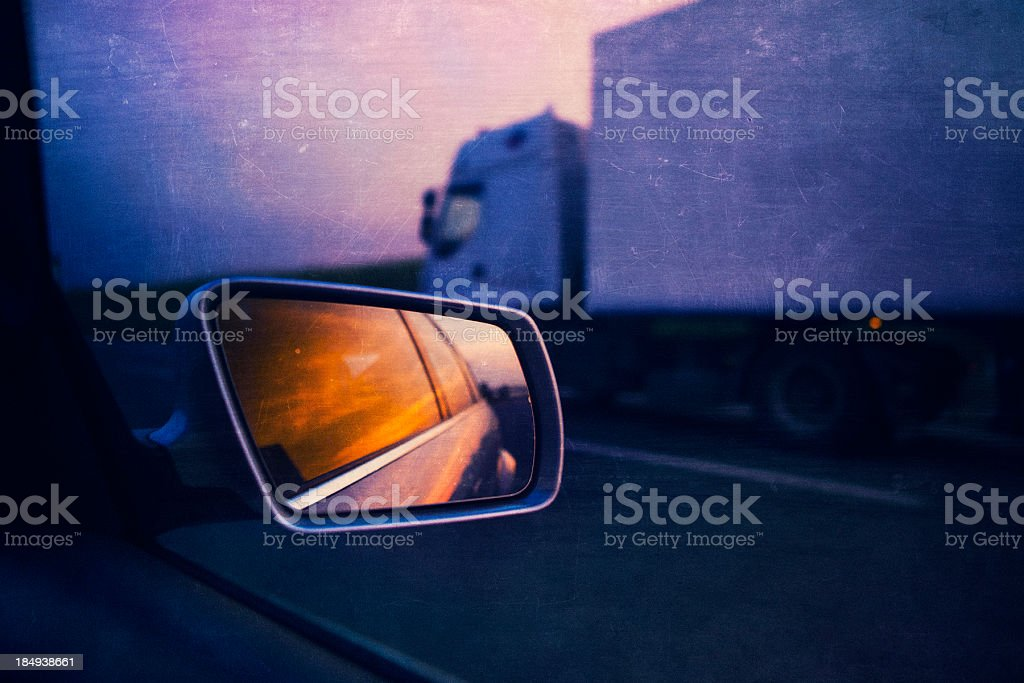 rear view mirror and semi-truck on the highway royalty-free stock photo