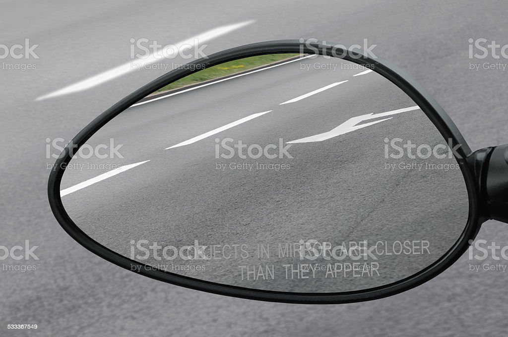 Rear view mirror warning text objects in are closer than stock photo