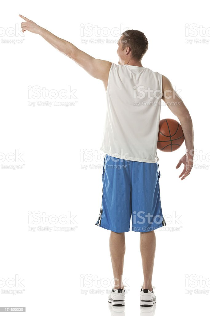 Rear view of a basketball player pointing royalty-free stock photo