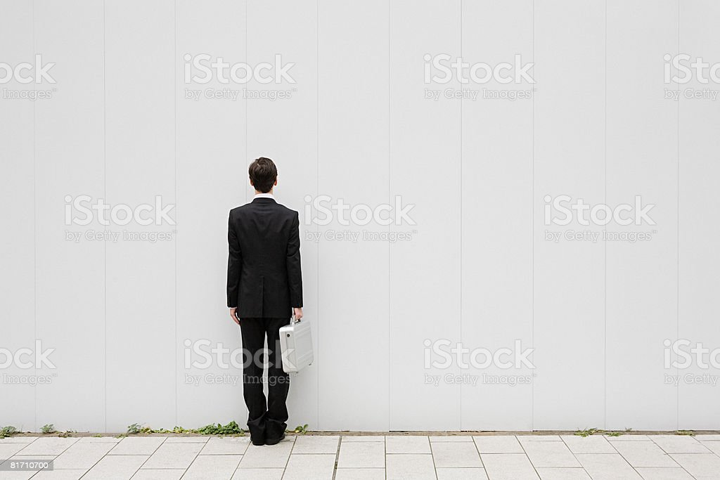 Rear view of a businessman stock photo