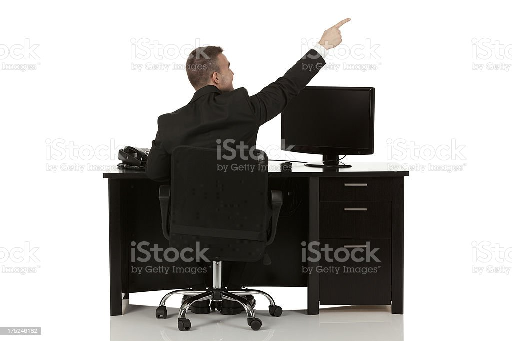Rear view of a businessman pointing royalty-free stock photo