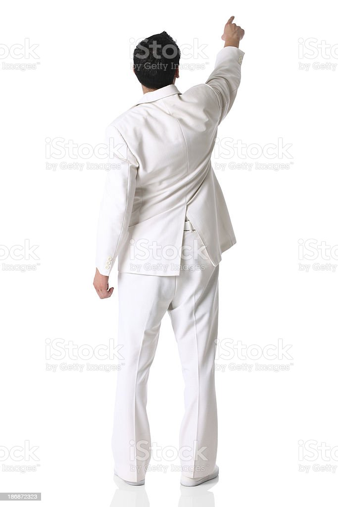 Rear view of a businessman pointing with finger stock photo