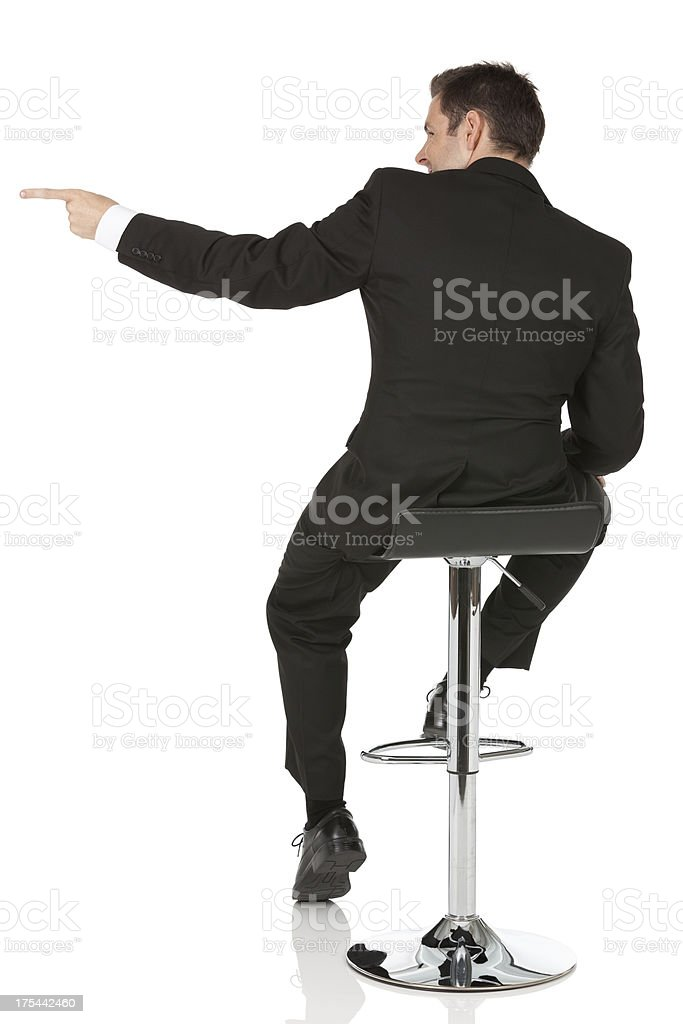 Rear view of a businessman sitting on stool royalty-free stock photo
