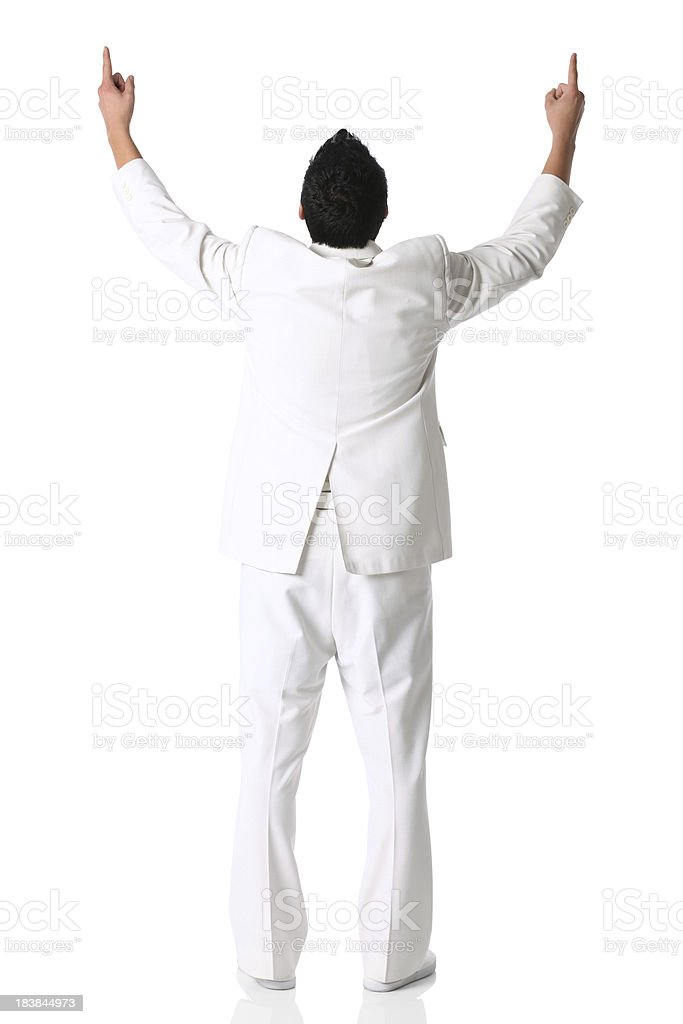 Rear view of a businessman standing with arms raised stock photo
