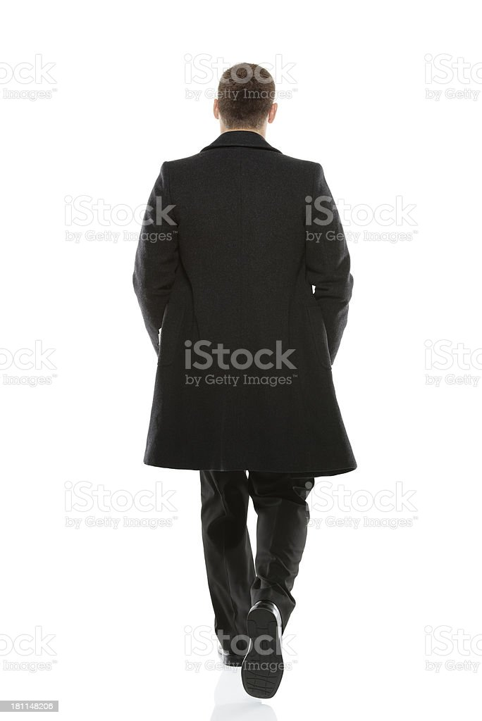 Rear view of a businessman walking stock photo