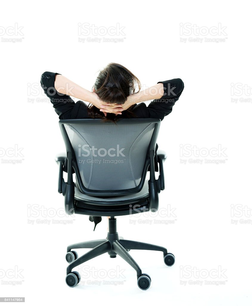 Rear view of a businesswoman relaxing stock photo