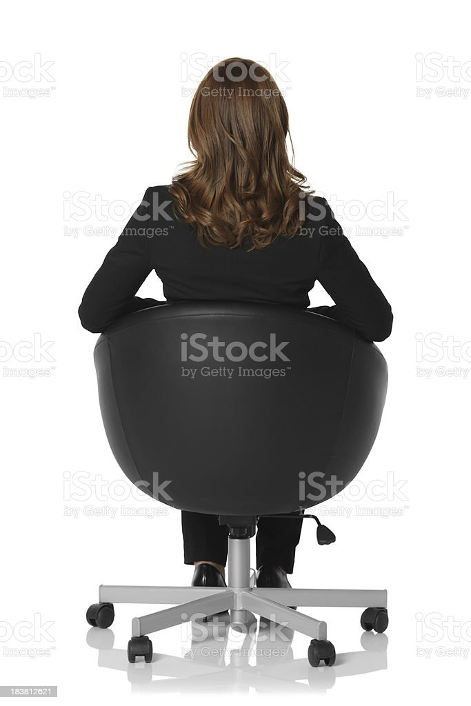 Rear view of a businesswoman sitting in chair royalty-free stock photo