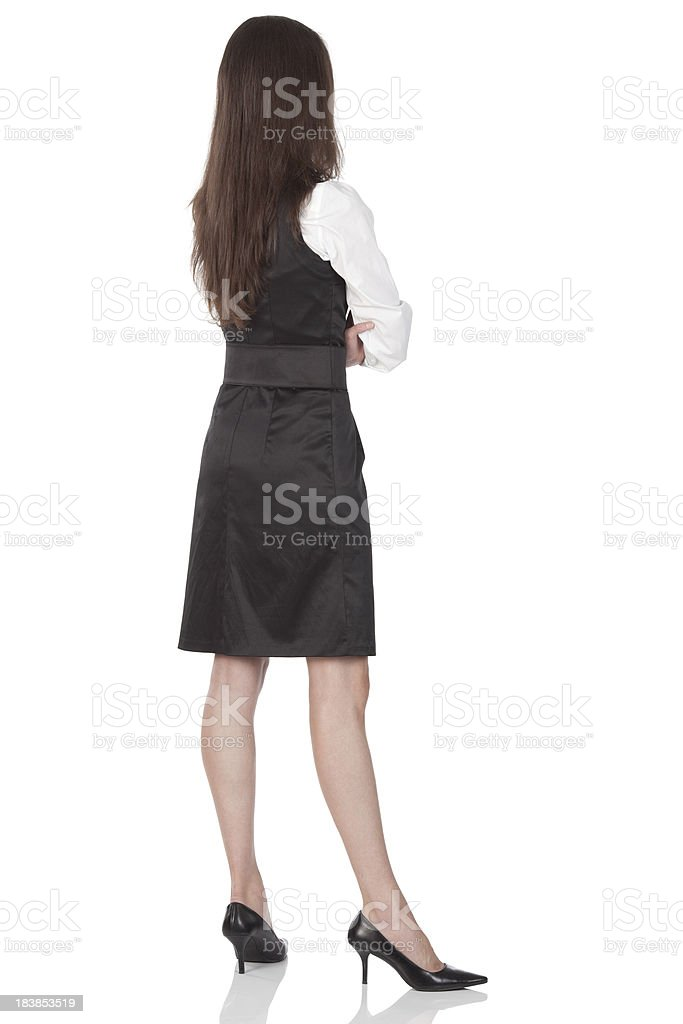 Rear view of a businesswoman standing with arms crossed royalty-free stock photo