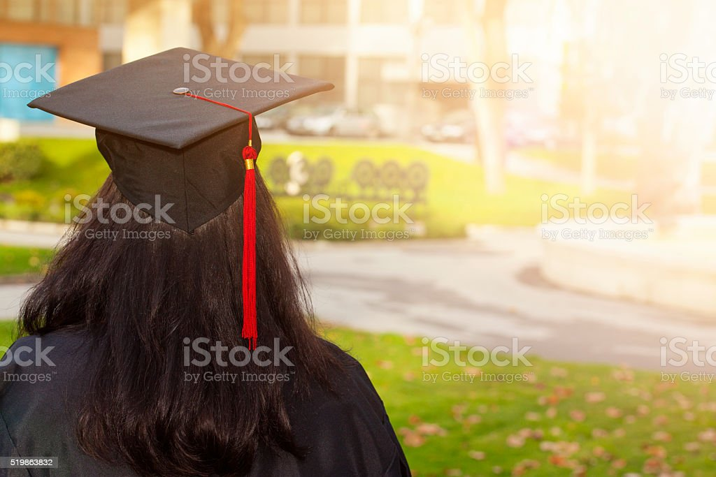 Rear view of a college graduate stock photo