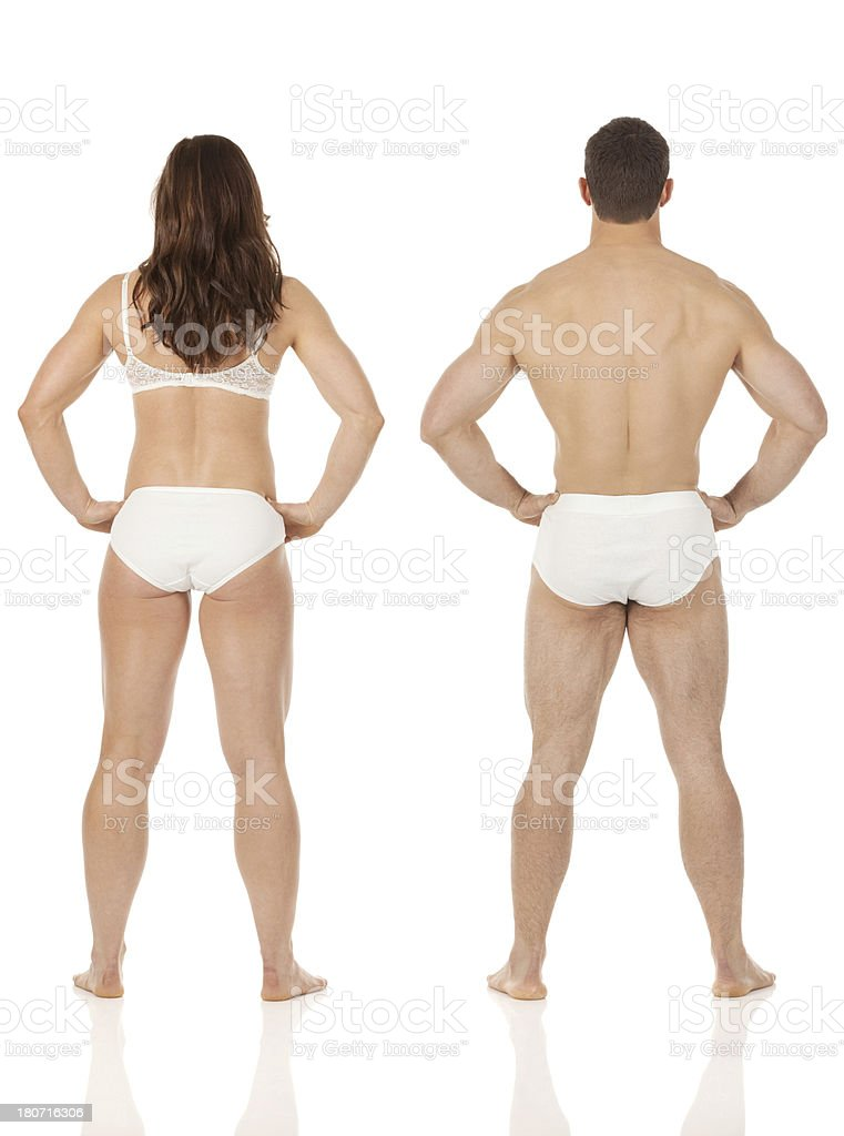 Rear view of a couple standing in undergarments royalty-free stock photo