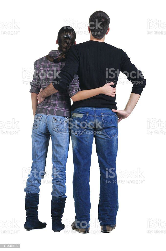 Rear view of a couple with their arms around each other royalty-free stock photo