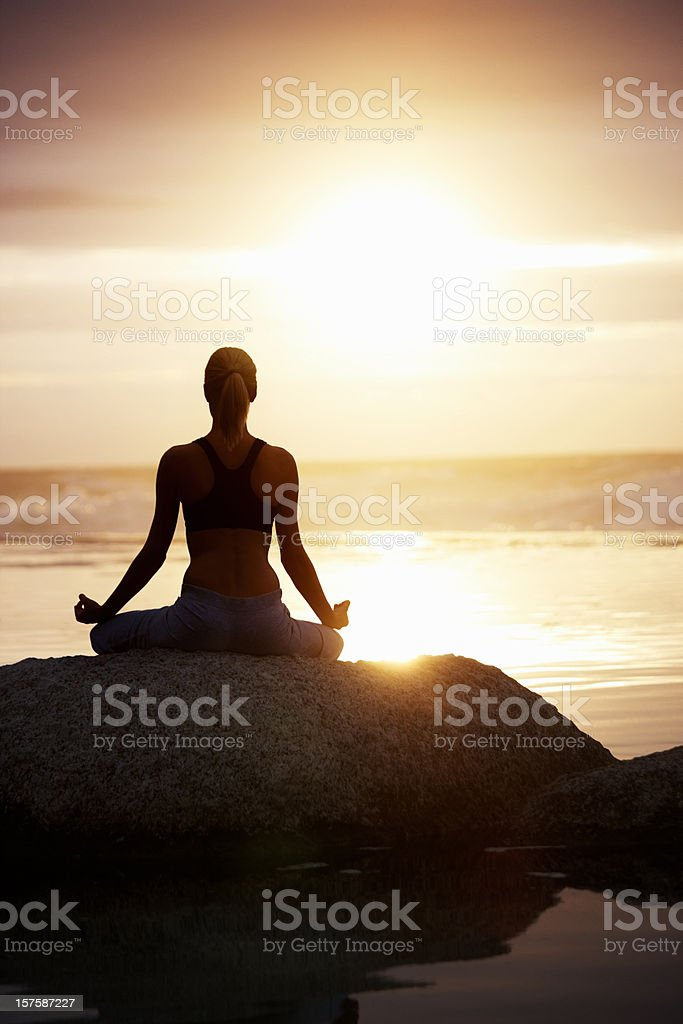 Rear view of a female practizing yoga royalty-free stock photo