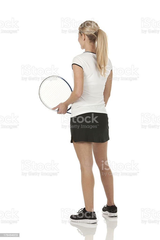Rear view of a female tennis player royalty-free stock photo