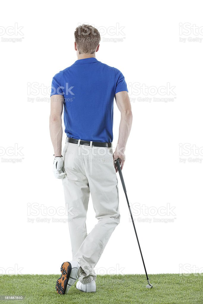 Rear view of a golfer standing in golf course royalty-free stock photo