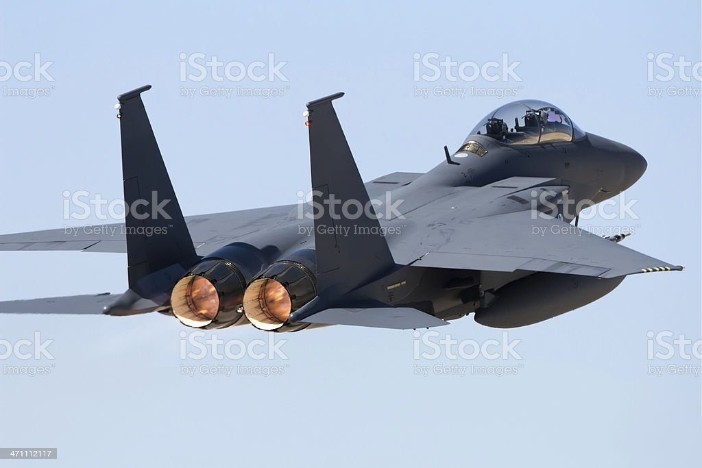 Rear view of a jet fighter in flight royalty-free stock photo