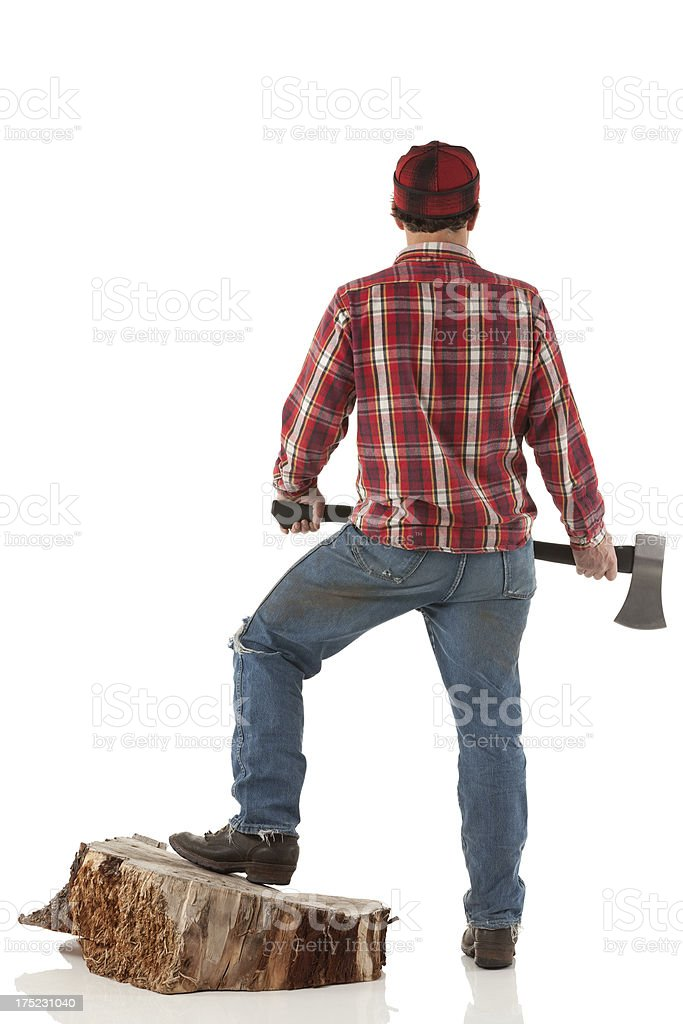 Rear view of a lumberjack with an axe royalty-free stock photo