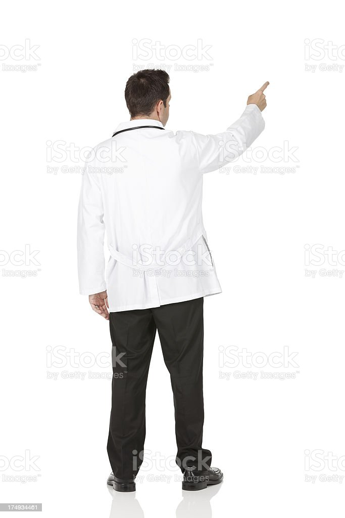 Rear view of a male doctor pointing stock photo