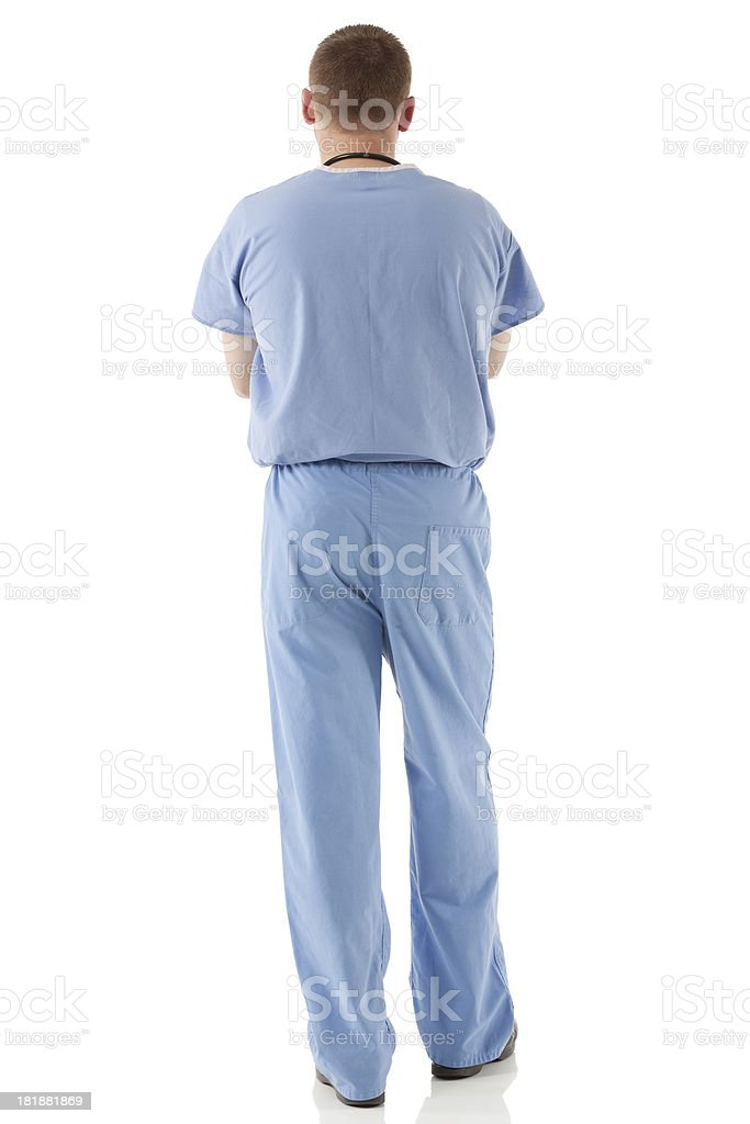 Rear view of a male nurse standing royalty-free stock photo