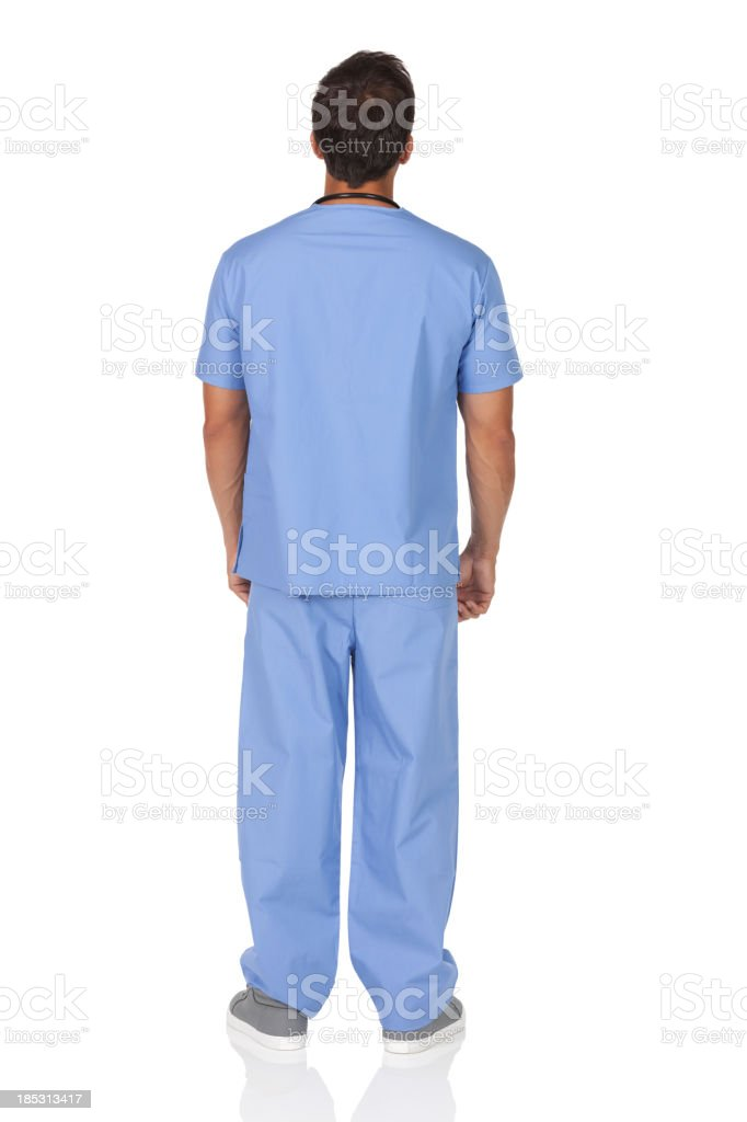 Rear view of a male nurse standing stock photo