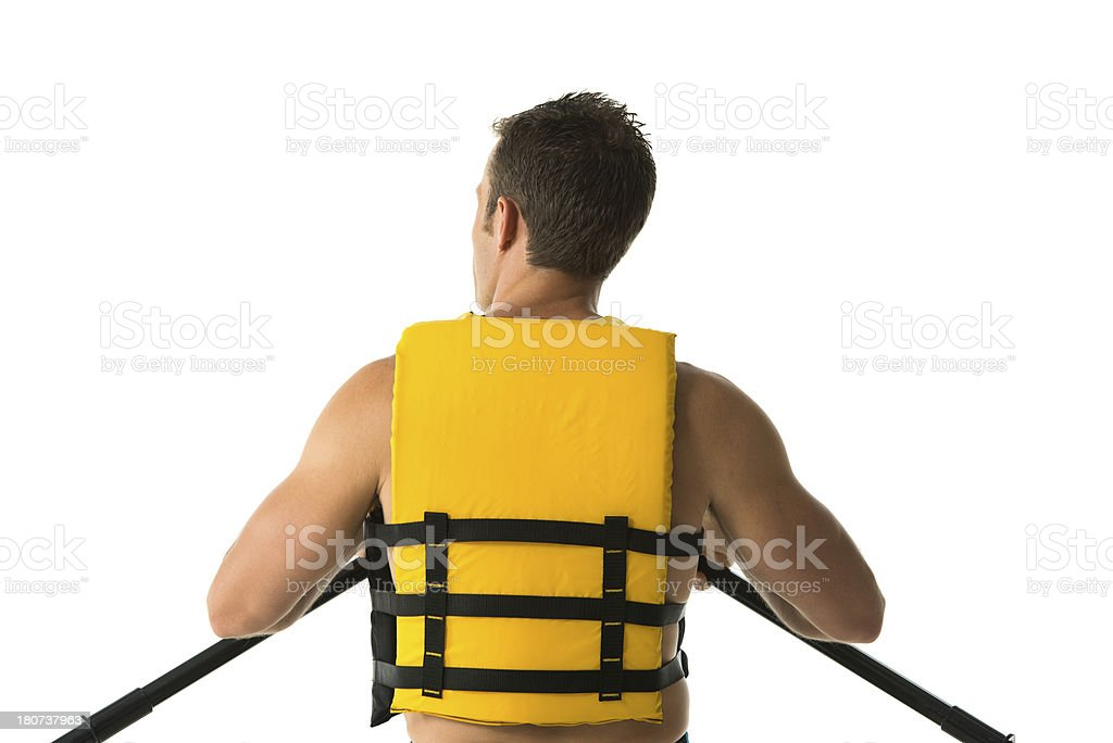 Rear view of a man canoeing against hwite royalty-free stock photo