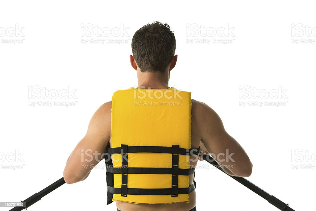 Rear view of a man canoeing royalty-free stock photo