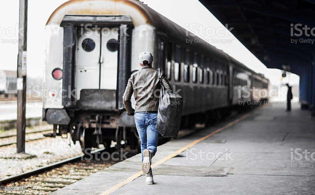 Rear view of a man catching the train. stock photo